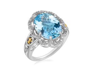 Ornate Oval Blue Topaz and Diamond Accented Fleur De Lis Motif Ring in 18K Yellow Gold and Sterling Silver (.03 ct. tw.)