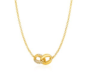 14K Yellow Gold and Diamond Necklace with Two-Link Infinity Symbol (1/4 ct. tw.)