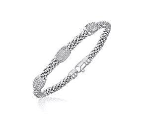 Barrel Station Diamond Accented Popcorn Bangle in Rhodium Finished Sterling Silver (.17ct tw)