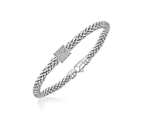 Diamond Accented Barrel Popcorn Bangle in Rhodium Finished Sterling Silver (.13ct tw)